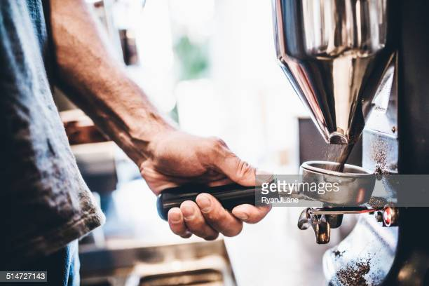 grinding espresso beans - ground coffee stock photos and pictures