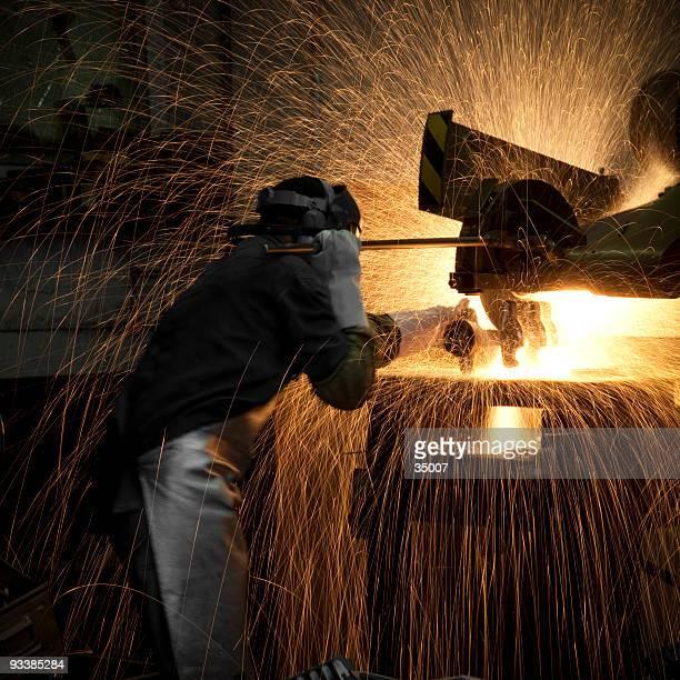 grinding steel worker