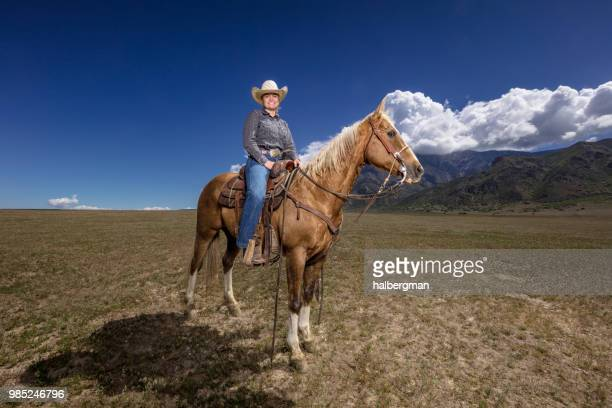 Grinning Cowgirl on Horseback