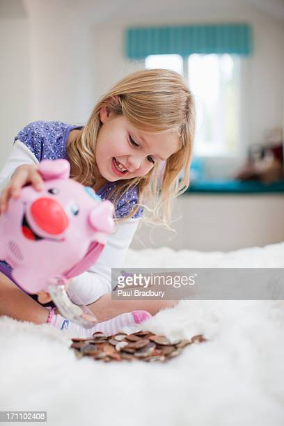 Grinning girl with piggy bank