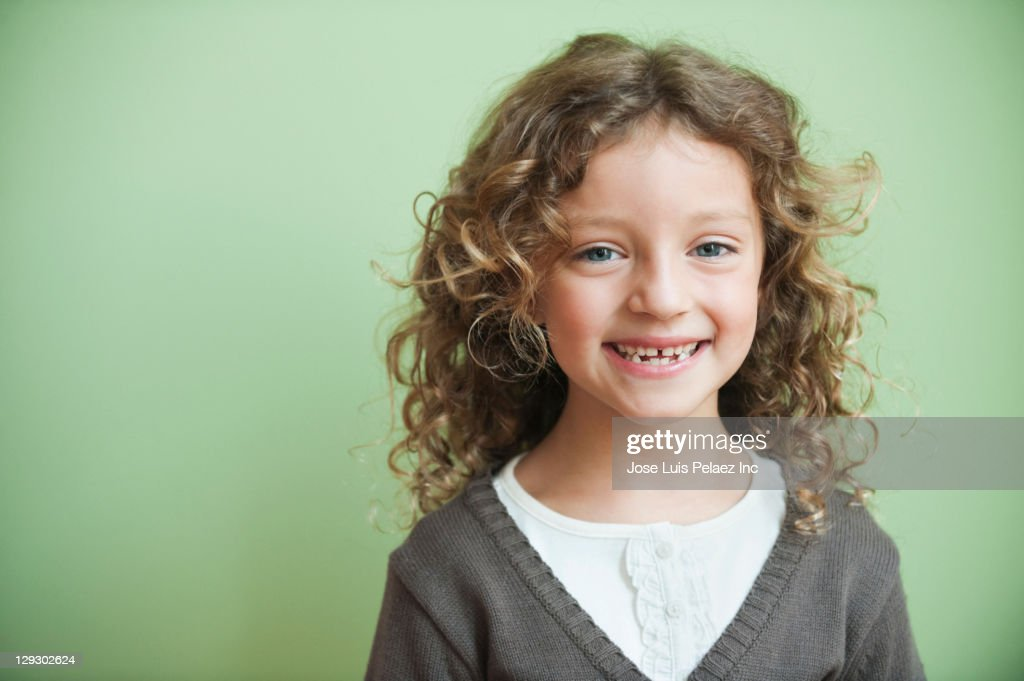 Grinning mixed race girl : Stock Photo