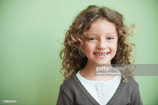 Grinning mixed race girl