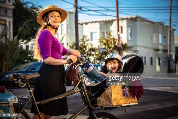 Grinning Mom and Toddler Posing on Sunny San Francisco Street with Cargo Bike