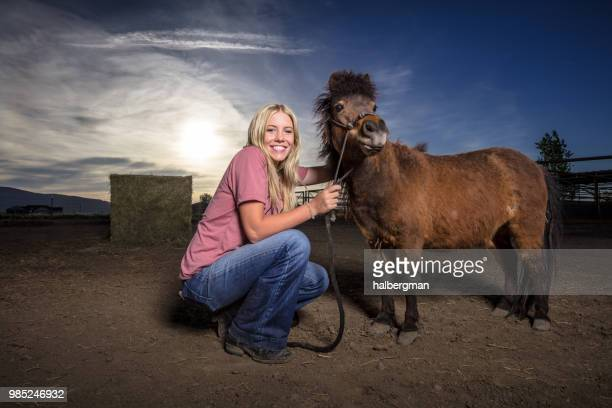 Grinning Woman with Miniature Horse