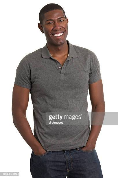 grinning young man standing - polo shirt stock pictures, royalty-free photos & images