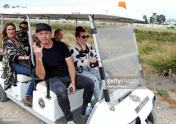 Grinspoon catch a ride on a golfcart backstage at the Big Day Out on 26th January 2013 at the Flemington Racecourse in Melbourne Australia