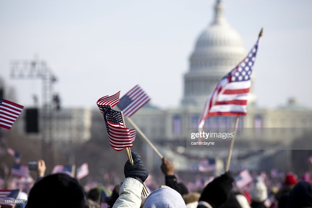 A grip of people holding flags in front of the White House : Stock Photo