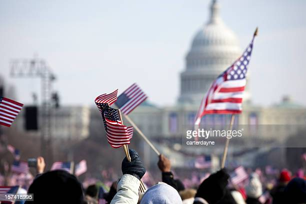 A grip of people holding flags in front of the White House
