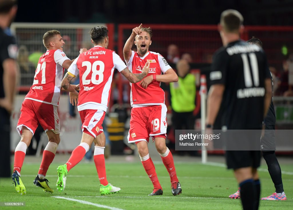 Grischa Proemel, Christopher Trimmel and Florian Huebner of 1 FC Union Berlin celebrate after scoring the 2:2 during the game between Union Berlin and the MSV Duisburg at the Stadion an der Alten Foersterei on september 14, 2018 in Berlin, Germany.
