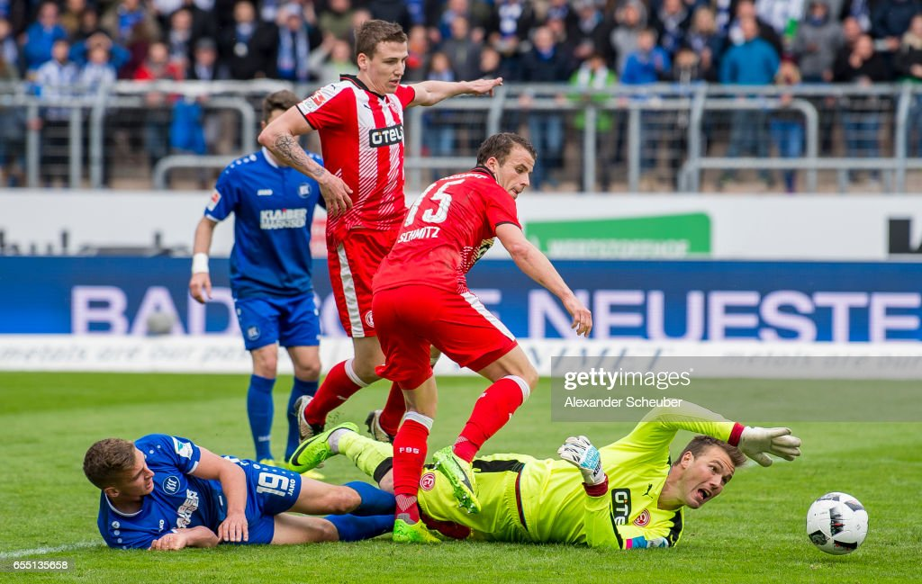 Grischa Proemel of Karlsruhe challenges Michael Rensing of Fortuna Duesseldorf during the Second Bundesliga match between Karlsruher SC and Fortuna Duesseldorf at Wildparkstadion on March 19, 2017 in Karlsruhe, Germany.