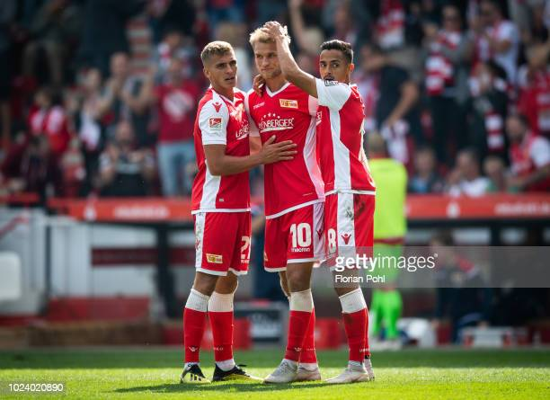 Grischa Proemel, Sebastian Andersson, Kenny Prince Redondo of 1 FC Union Berlin celebrate after scoring the 4:1 during the 2nd Bundesliga match...