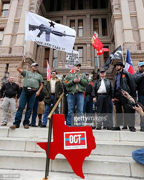 J Grisham of Open Carry Texas speaks on the state capitol steps at the Texas state capitol on January 1 2016 in Austin Texas On January 1 the open...
