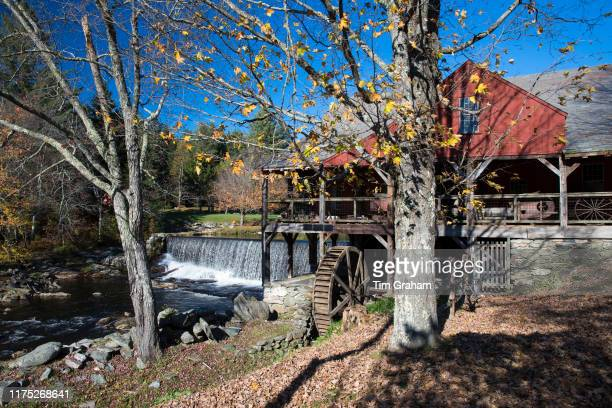 Grist Mill and The Old Mill Museum by the West River waterfall in Southern Vermont New England USA