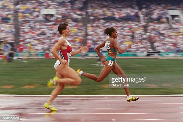 Grit Breuer and Cathy Freeman compete during the Women's 400meter quarterfinal at the 1996 Olympic Games
