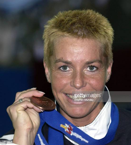Grit Breuer of Germany celebrates with her bronze medal in the Womens 400m Final during the 9th IAAF World Indoor Athletics Championships at the...