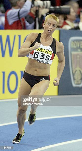 Grit Breuer of Germany in action in the Womens 400m heats during the 9th IAAF World Indoor Athletics Championships at the National Indoor Arena...