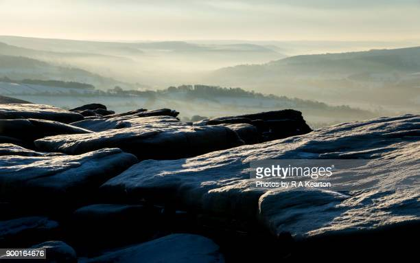 gritstone rocks on bamford edge in winter, peak district, derbyshire - escarpment stock pictures, royalty-free photos & images