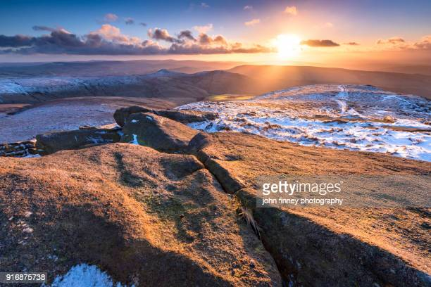 Gritstone sunset from Kinder Scout. English Peak District. UK.