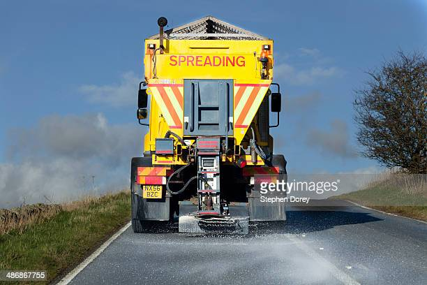gritter lorry spreading salt, northumberland uk - road salt stock pictures, royalty-free photos & images