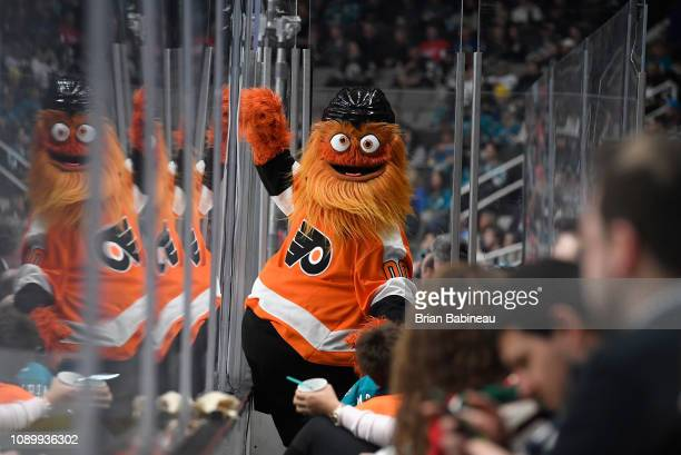 Gritty of the Philadelphia Flyers bangs on the glass from the stands during the 2019 Honda NHL AllStar Game at SAP Center on January 26 2019 in San...