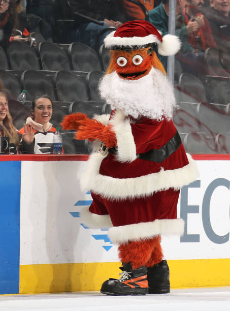 Gritty, the mascot of the Philadelphia Flyers dressed as Santa entertains the crowd during the second period intermission against the New York...