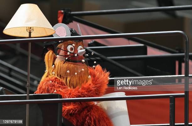 Gritty the mascot of the Philadelphia Flyers enjoys popcorn druing an NHL game against the Pittsburgh Penguins on January 15, 2021 at the Wells Fargo...