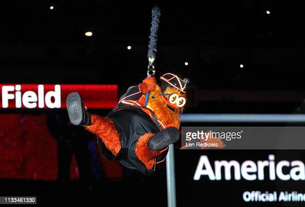 Gritty the mascot of the Philadelphia Flyers enters the stadium during a pregame ceremony prior to his team playing against the Pittsburgh Penguins...