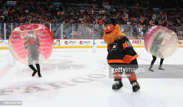Gritty, the mascot of the Philadelphia Flyers entertains the crowd during the second period intermission against the New Jersey Devils on October 20,...
