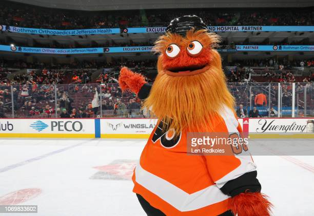 Gritty the mascot of the Philadelphia Flyers entertains the crowd during the first period intermission against the New Jersey Devils on November 15...