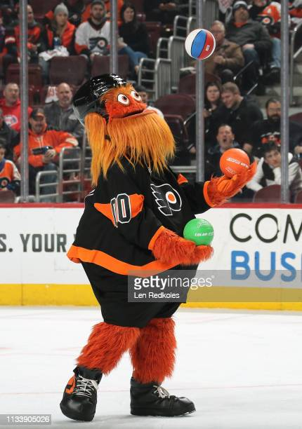 Gritty the mascot of the Philadelphia Flyers juggles during the second period intermission against the Buffalo Sabres on February 26 2019 at the...