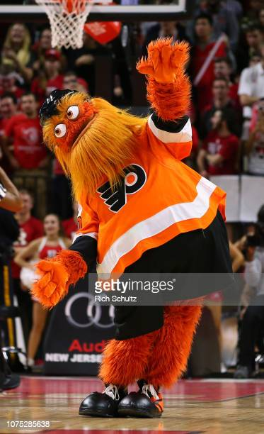 Gritty the mascot of the Philadelphia Flyers NHL hockey team performs during a college basketball game between the Michigan State Spartans and...