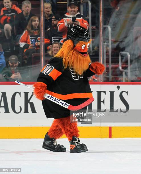Gritty the mascot of the Philadelphia Flyers plays hockey during the second period intermission against the Vegas Golden Knights on October 13 2018...