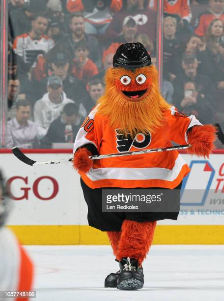 Gritty the mascot of the Philadelphia Flyers plays hockey during the second period intermission against the Florida Panthers on October 16 2018 at...
