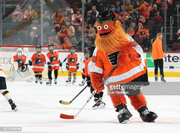 Gritty the mascot of the Philadelphia Flyers plays hockey during the first period intermission against the Tampa Bay Lightning on November 17 2018 at...