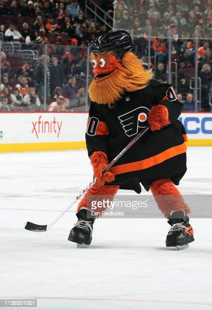 Gritty the mascot of the Philadelphia Flyers plays hockey during the second period intermission at an NHL game against the New York Islanders on...