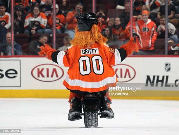 Gritty the mascot of the Philadelphia Flyers rides a unicycle during the second period intermission at an NHL game against the Montreal Canadiens on...