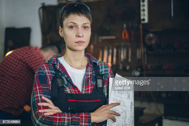 Gritty woman in workshop
