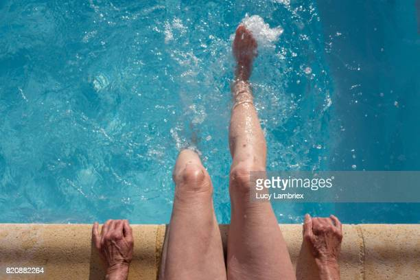 gritty women, active senior woman at pool - poolside stock pictures, royalty-free photos & images