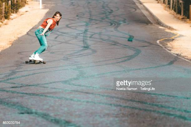 Gritty Women: woman longboard skating