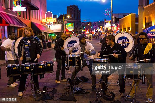 Grizz Line drummers and percussion band live in Beale Street entertainment district famous for Rock and Roll Jazz and Blues