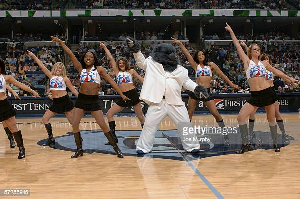 Grizz the Memphis Grizzlies mascot leads the Grizzlies Dance Team in a routine during the game against the Denver Nuggets at FedExForum on March 17...