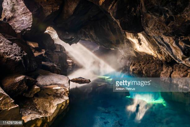 grjotagja volcanic cave with hot thermal water near lake myvatn, iceland - volcanic terrain stock pictures, royalty-free photos & images