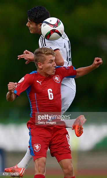 Görkem Saglam of Germany U17 jumps for the ball with Michal Sadílek of Czech Republic U17 during the UEFA European Under17 Championship match between...