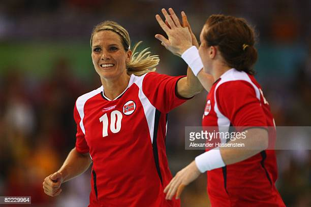 Gro Hammerseng of Norway celebrates after scoring a goal with team mate Karoline Dyhre Breivang during the handball match between Norway and China...