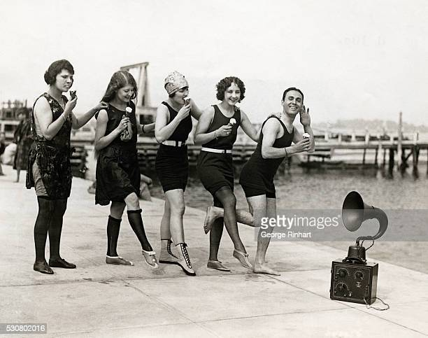 Groasopaint celebrities have a perfectly lovely time dancing to the radio on the dock and eating ice cream