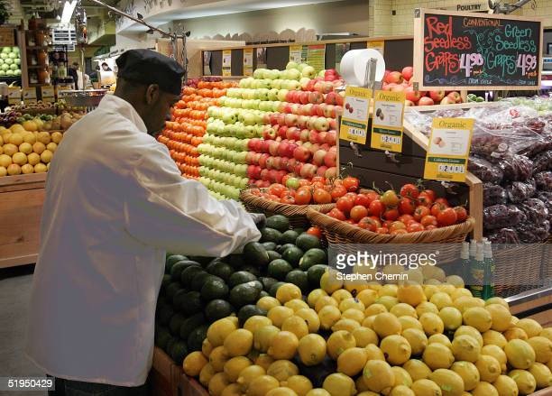 A grocer arranges avocados and lemons in the produce section at Whole Foods January 13 2005 in New York City New eating guidelines issued by the US...