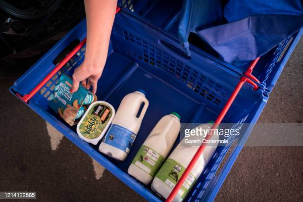 Groceries are collected at a Tesco Click Collect pick up point as social distancing to stop the spread of the coronavirus prompts different ways of...