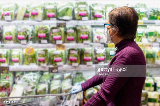 groceries during coronavirus - liyao xie stock pictures, royalty-free photos & images