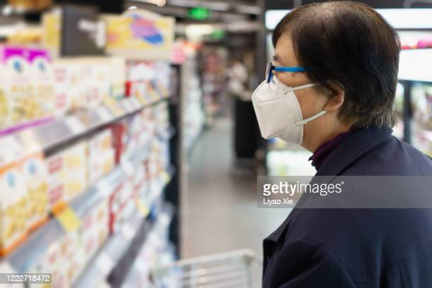groceries during coronavirus - new normal stock pictures, royalty-free photos & images