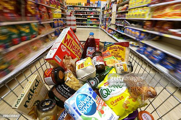 Groceries in a shopping cart move through a food aisle at the Tesco Basildon Pitsea Extra supermarket operated by Tesco Plc in Basildon UK on Tuesday...